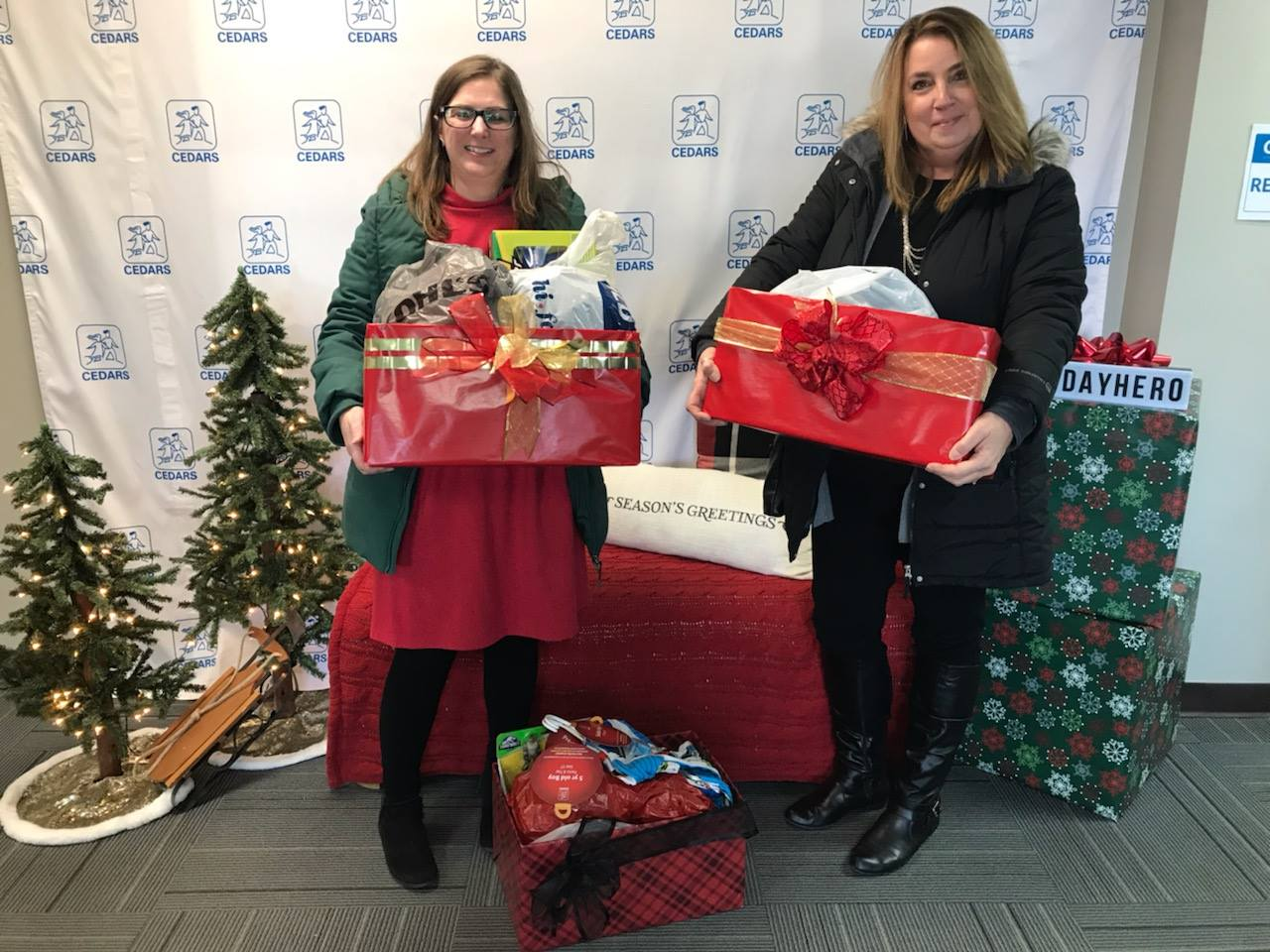 NAI FMA professionals dropping of donations of gifts