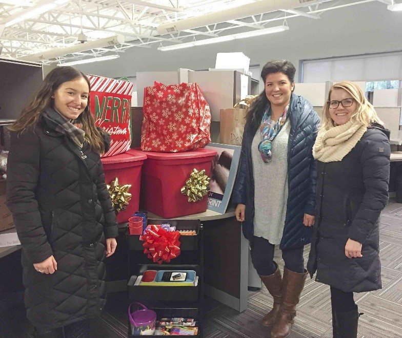 NAI Wisinski professionals with gifts for the young people of Wedgwood