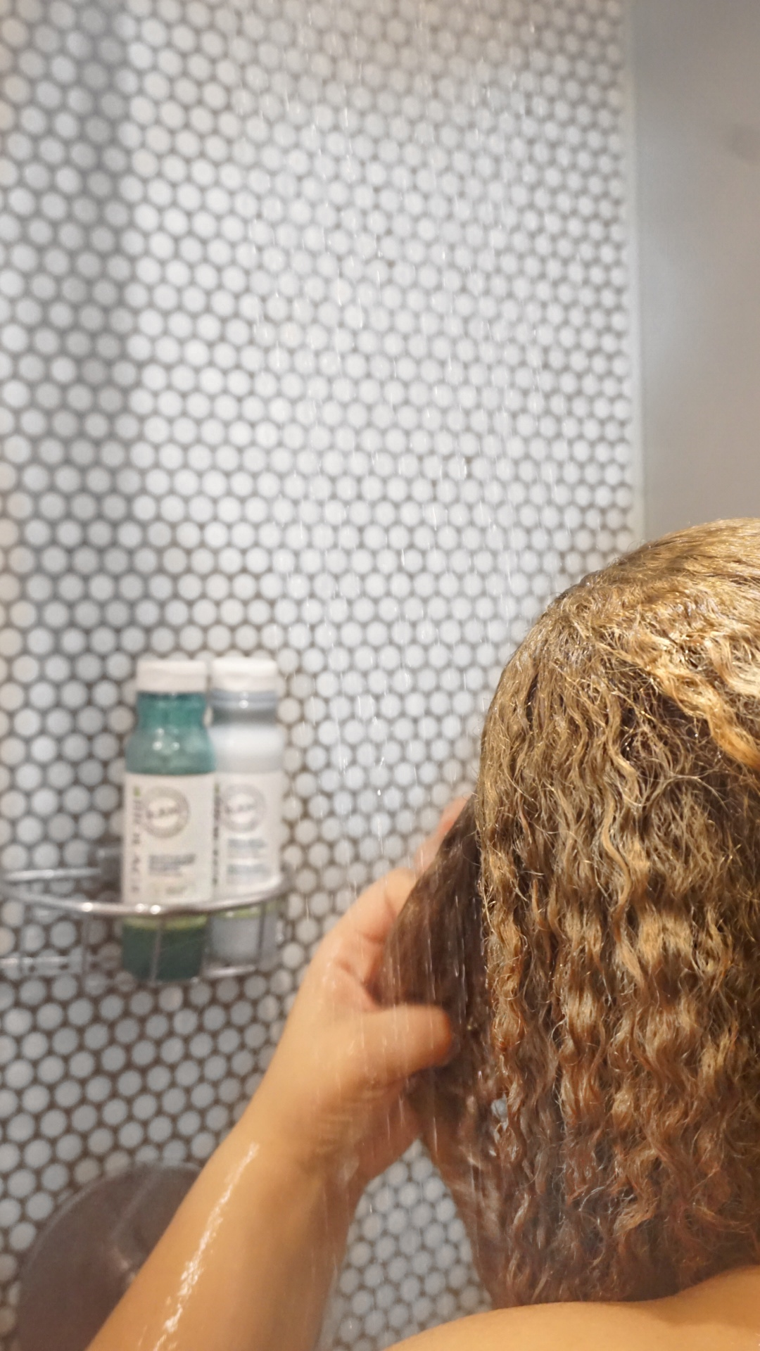 While you are keeping your scalp clean and clear keep your shower clear and clean. Meaning get rid of feeling like you are showering in a space that looks like the isle at a Target store . You really don't need all that chaos or products. So, in 2019 get rid of the shampoo and conditioner that has been sitting in your shower for months and introduce a spa like feel to your hair cleansing experience. Choose just one Cleanser and one Conditioner per seasons.