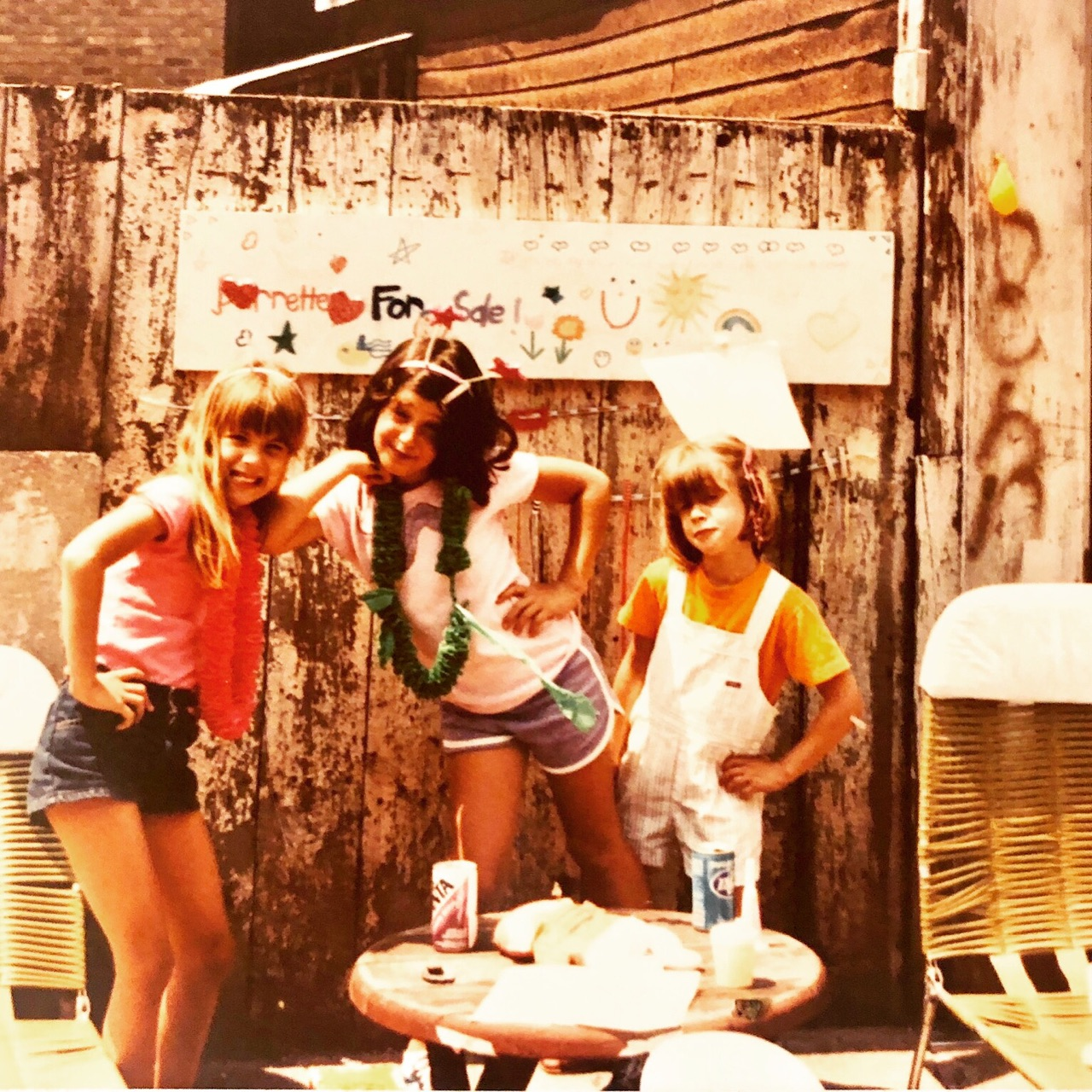 The owner, Larisa, hustling her wares (barrettes actually,) in a Dayton Street (Lincoln Park) garage sale in the DePaul area, 1981. All the women in this picture have become entrepreneurs.