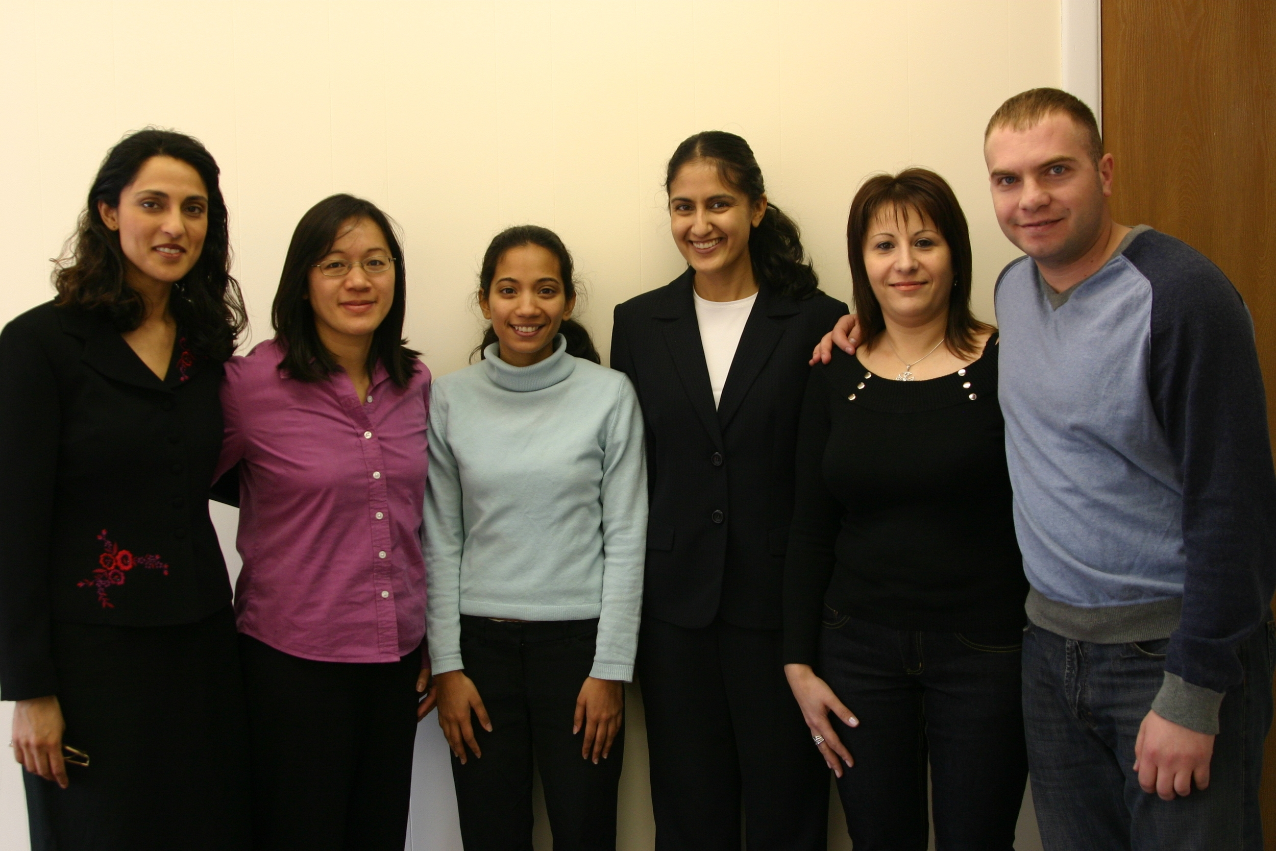 Attorney Samia Chandraker with staff and sports clients