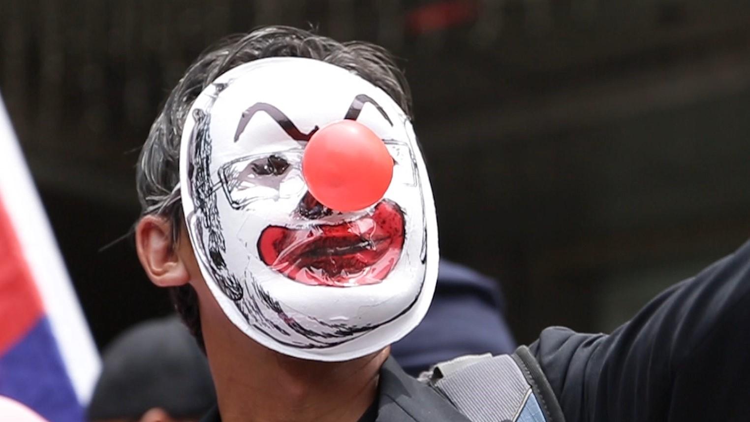 Kelptocrats_DogWoof_02.39_Clown Faced Protester_903977.jpg