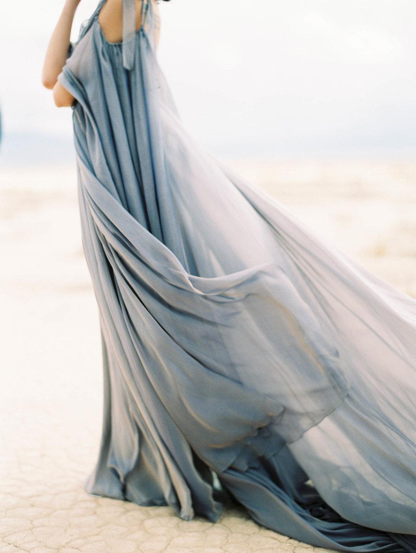 Windswept Bridals Under A Stormy Desert Sky