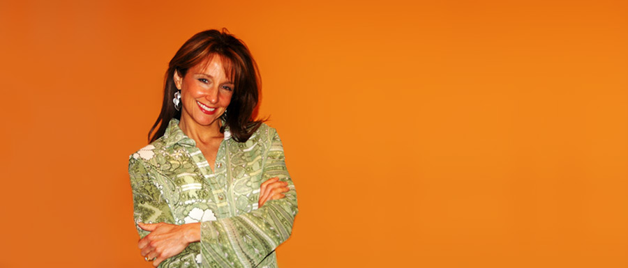 author-dena-harris-in-green-orange-wall.jpg