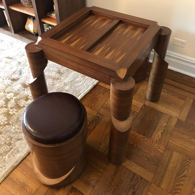 'Grandmaster' Game Table ~ Wouldn't it be perfect for @sho_billions #chuckrhoades 😂The table has inset backgammon. A 2 sided lid has Chess board on one side and simple Walnut veneer on other side. A magnet is hidden in the lid to lift it up. The design of the table and matching stools was inspired by hierarchy of chess pieces. Walnut & Maple Veneer & Maroon Leather #teamaxe #teamchuckrhoades