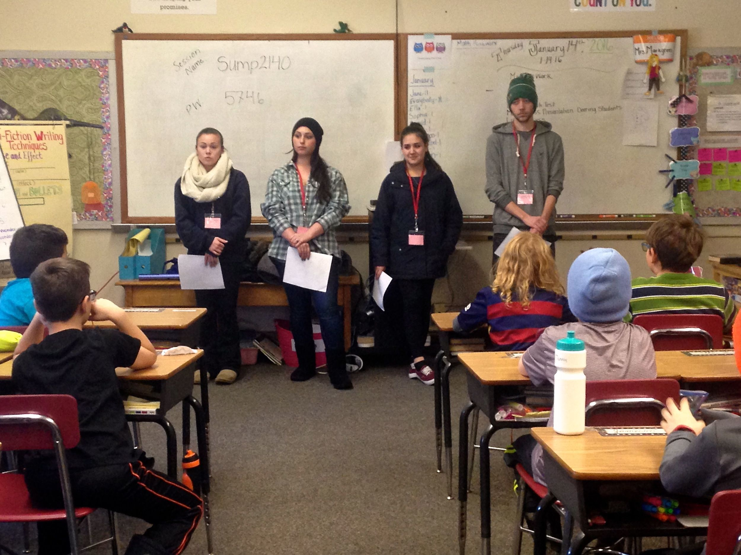 Cassie, Hannah, Anca, and Dylan teach mindfulness to a third grade classroom at Longfellow Elementary.