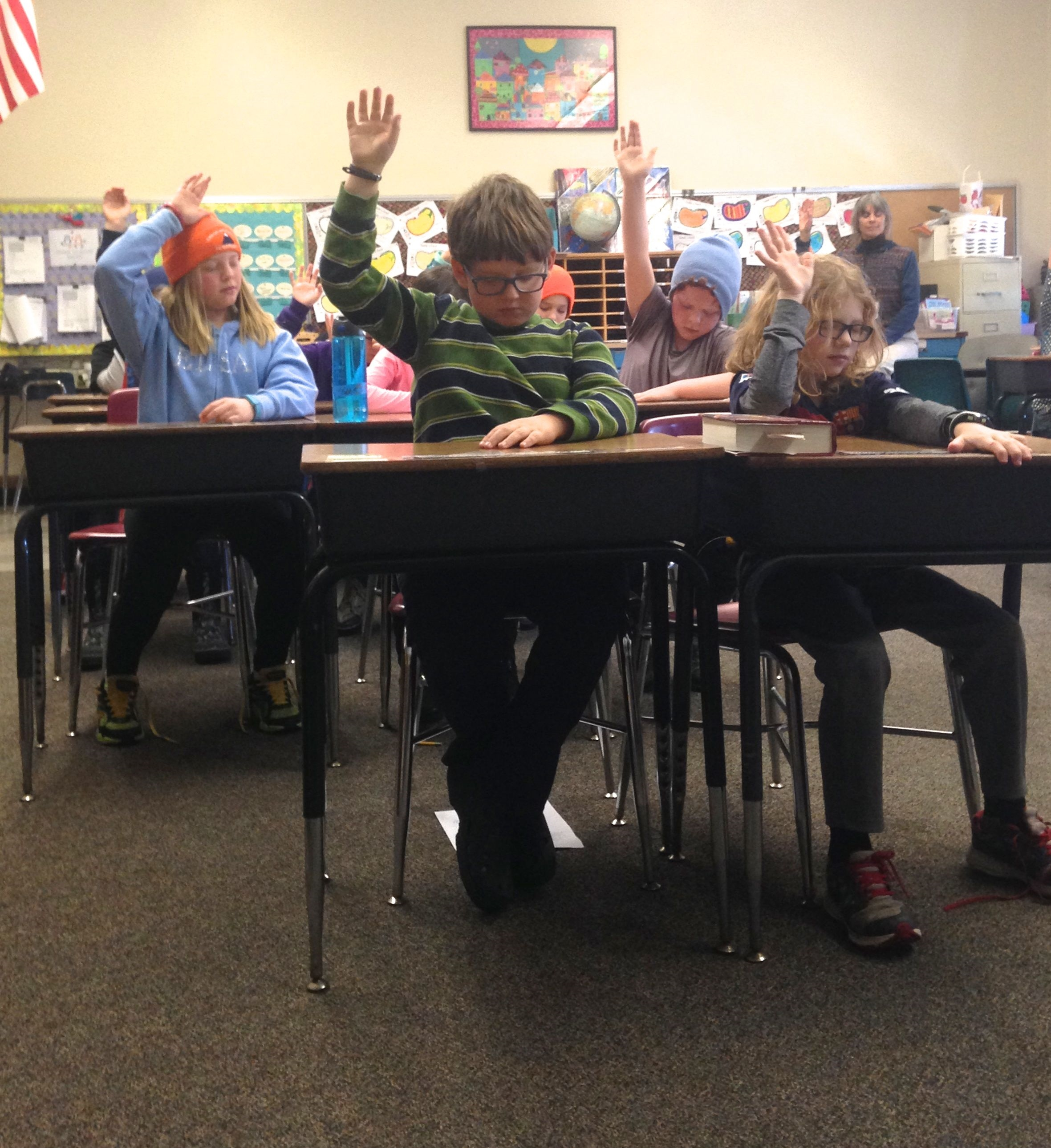 Students raise their hand when they can no longer hear the sound of the bell.