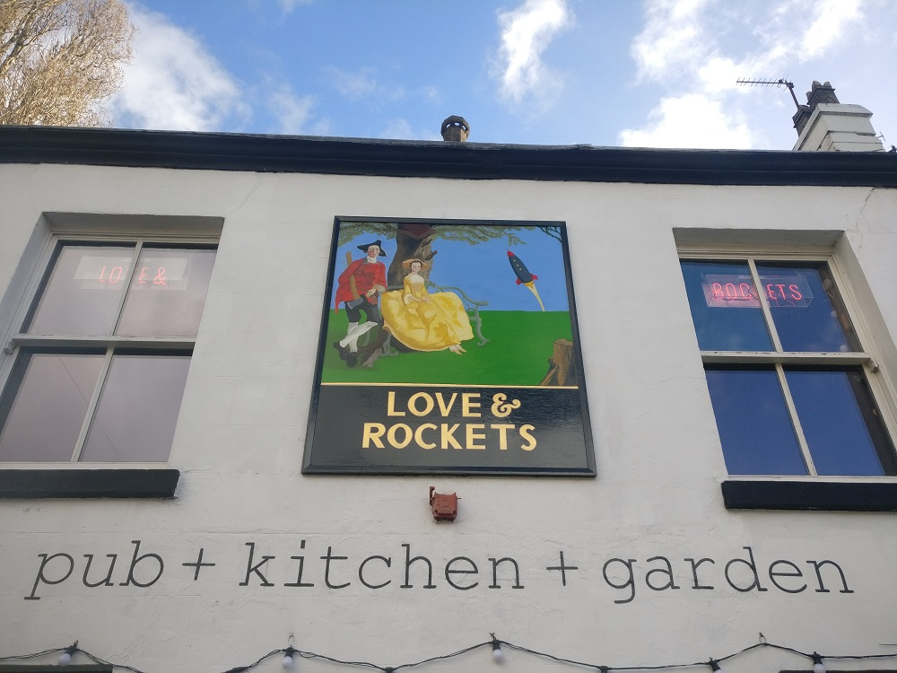 Hand painted pub style pictoral sign and wall lettering at Love & Rockets, Liverpool.