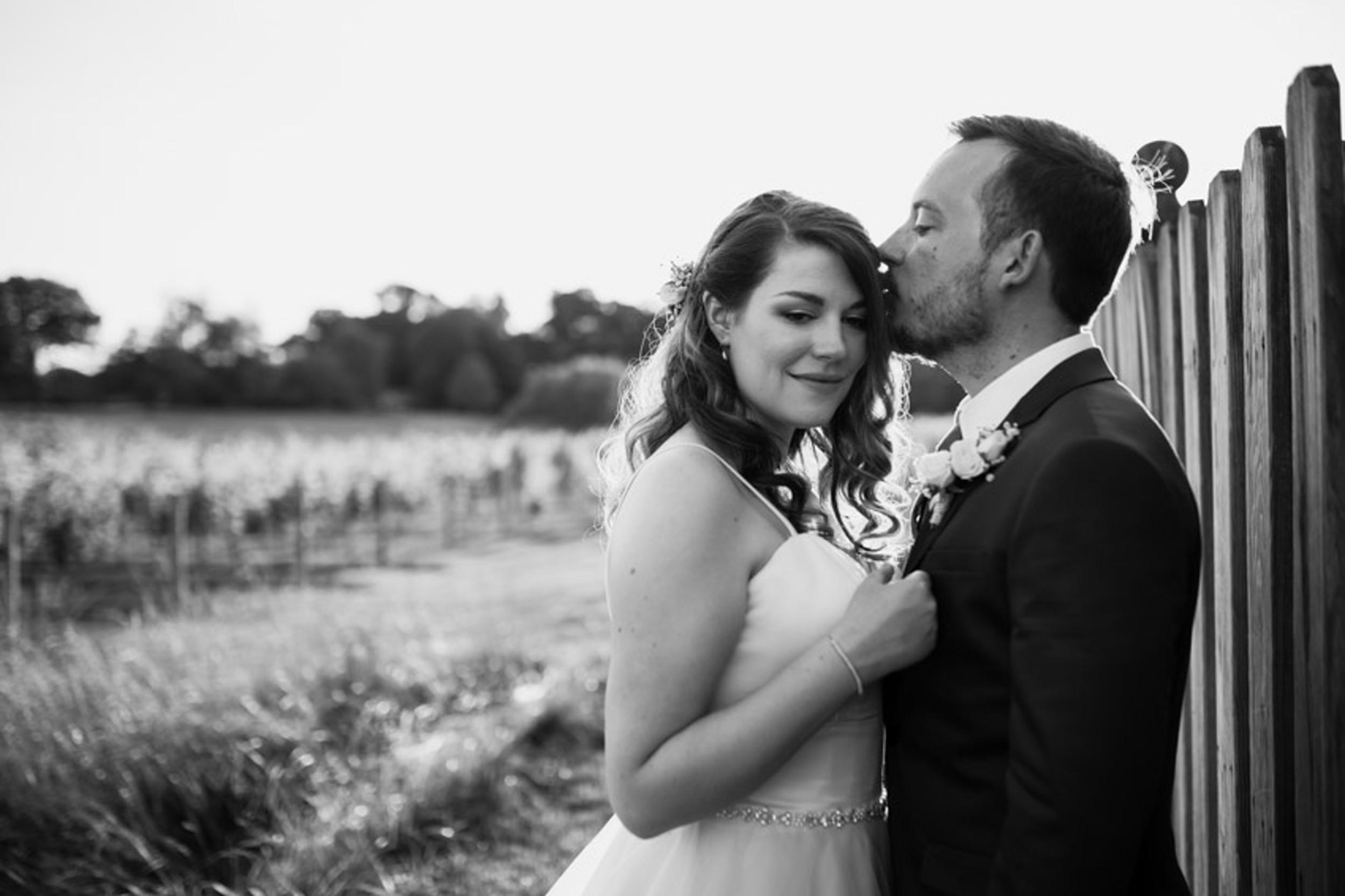Romantic Winery Wedding Kiss