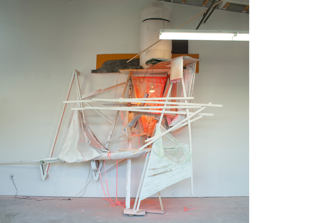 UNDER CONSTRUCTION NO. 1    site specific installation with wood, cellophane, aluminum, acrylic paint, spray enamel, cardboard, light bulbs, fan, extension cords, clear polyethylene sheeting, vinyl siding, flagging tape, and bubble wrap, 178 x 196 x 62 inches, 2013
