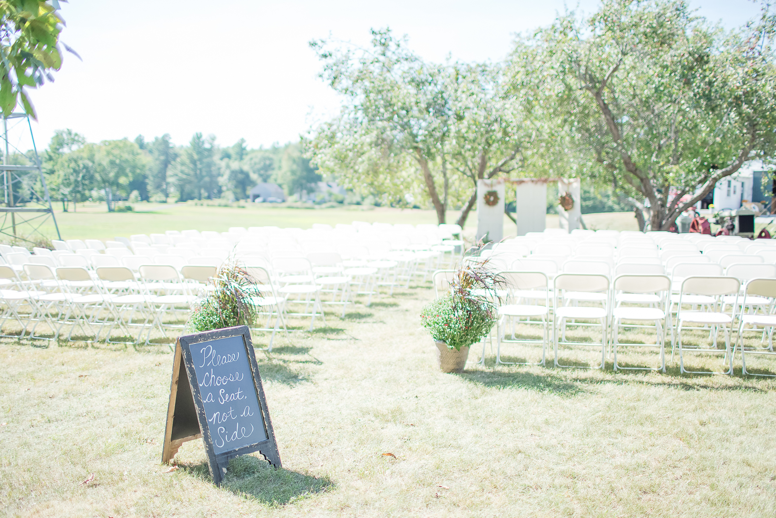 Chalk Board Wedding Sign | Pick A Seat Not A Side | Wedding Ceremony Under Apple Trees | NH Farm Wedding | Amy Brown Photography