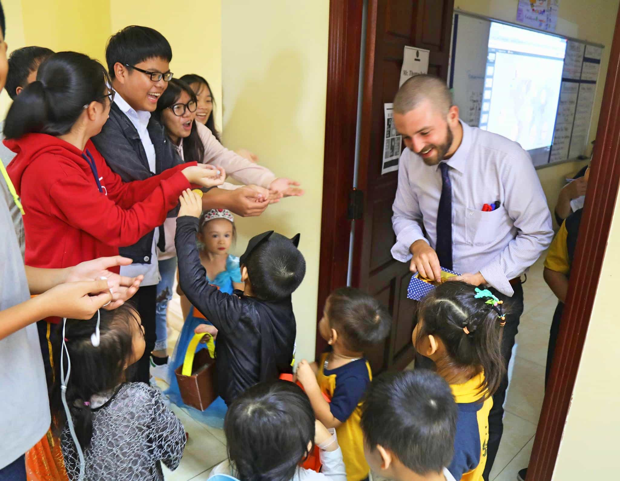 Handing out candy for Halloween while working at APU International School Da Nang, Vietnam