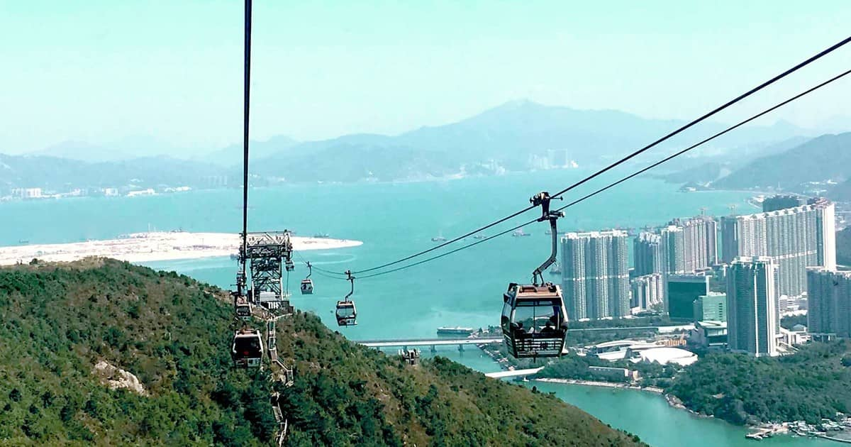 Ngong Ping 360 Cable Car -   Cost $16 -  The cable car journey offers a 25-minute aerial alternative to the current one-hour journey by Tung Chung Rd, allowing visitors to glide across Chung Bay and up to Lantau Island towards Ngong Ping Plateau. From the cable car you will get a view of the city, bay, big Buddha and Po Lin Monastery.