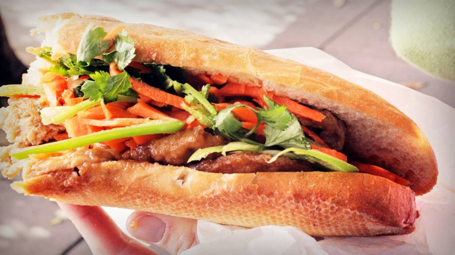 Banh Mi -   Cost $1.00 -  Bánh mì is the Vietnamese word for bread. Bread, or more specifically the baguette, was introduced by the French during the colonial period in Vietnam. These baguettes are usually stuffed with a local Pâté (a mixture of cooked ground meat and fat minced into a spreadable paste), vegetables and an egg.