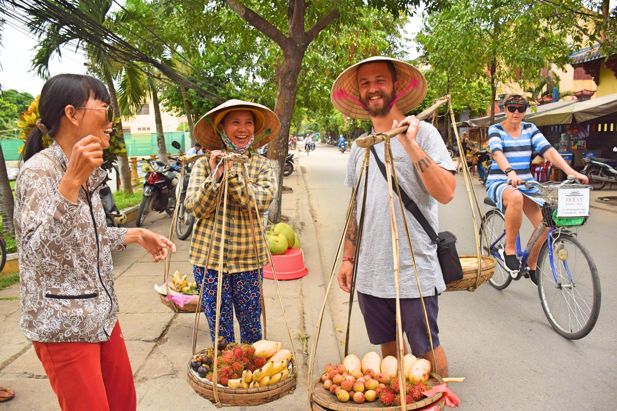 "A typical Hoi An scam: ""Take a photo, it's free"" they say. Worth it though ;)"