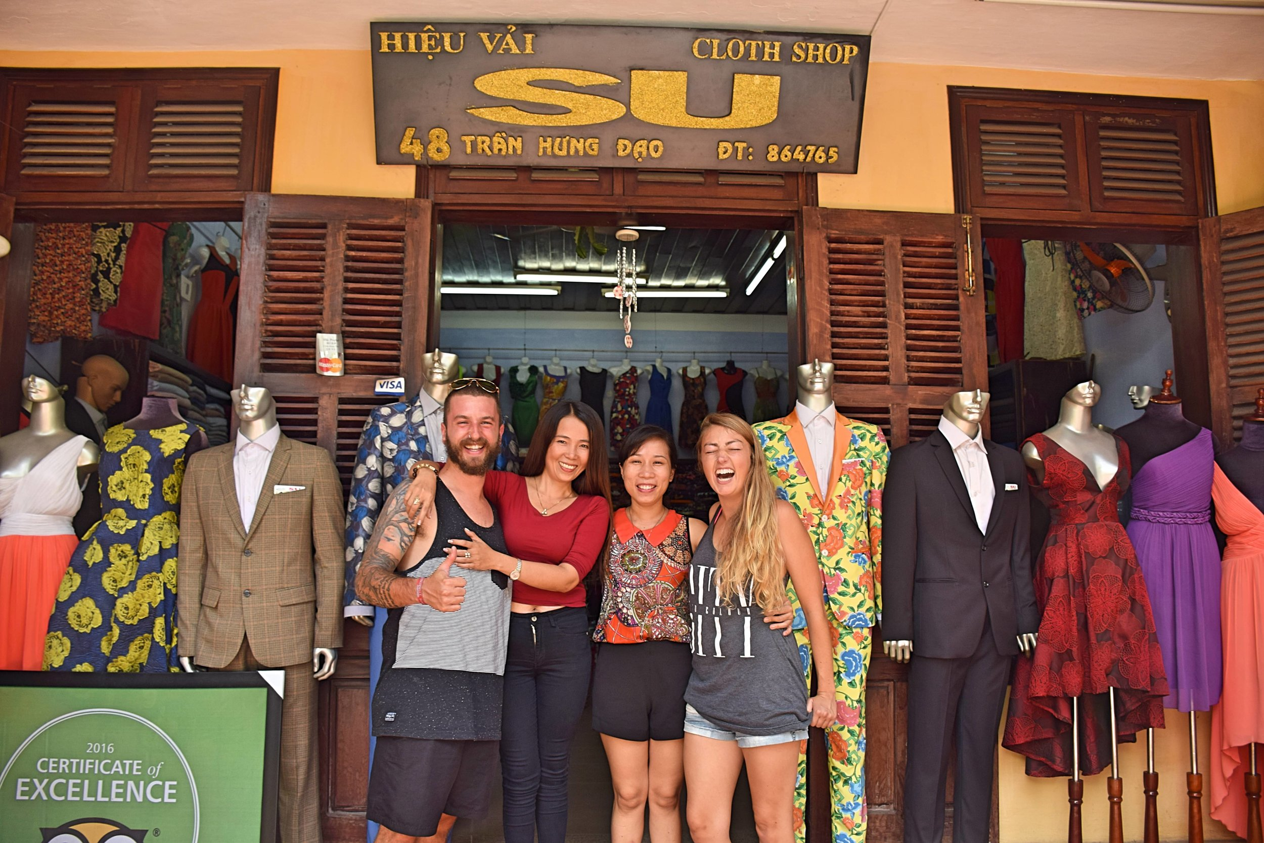 We had the suits made here: Cloth Shop Su
