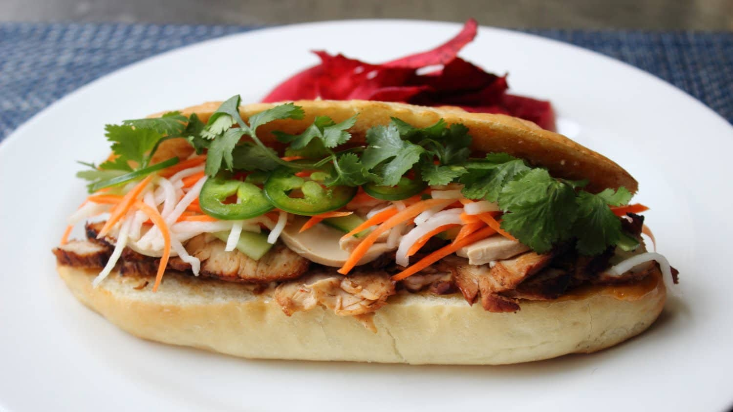 Banh Mi -   Cost $1.00 -  Bánh mì is the Vietnamese word for bread. Bread, or more specifically the baguette, was introduced by the French during the colonial period in Vietnam. These baguettes are usually stuffed with a Pâté, vegetables and an egg. You can find these literally everywhere, anytime of the day for around 0.60 USD.