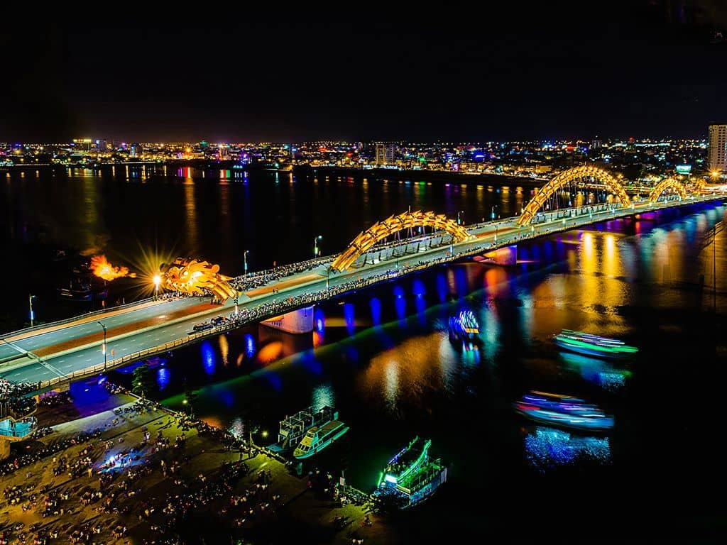 DA NANG - Dragon Bridge  -  Free to visit -  This super cool bridge crosses the Han River and is a ironic 666m long. What's cool about this bridge is every Saturday and Sunday at 9pm, the bridge is closed to traffic for 15 minutes while it breathes fire and water over the surrounding spectators. *We personally recommend visiting 7 Bridges Brewery for an awesome view of the show and a great IPA. This is a much better view than being in the crowds on the street.