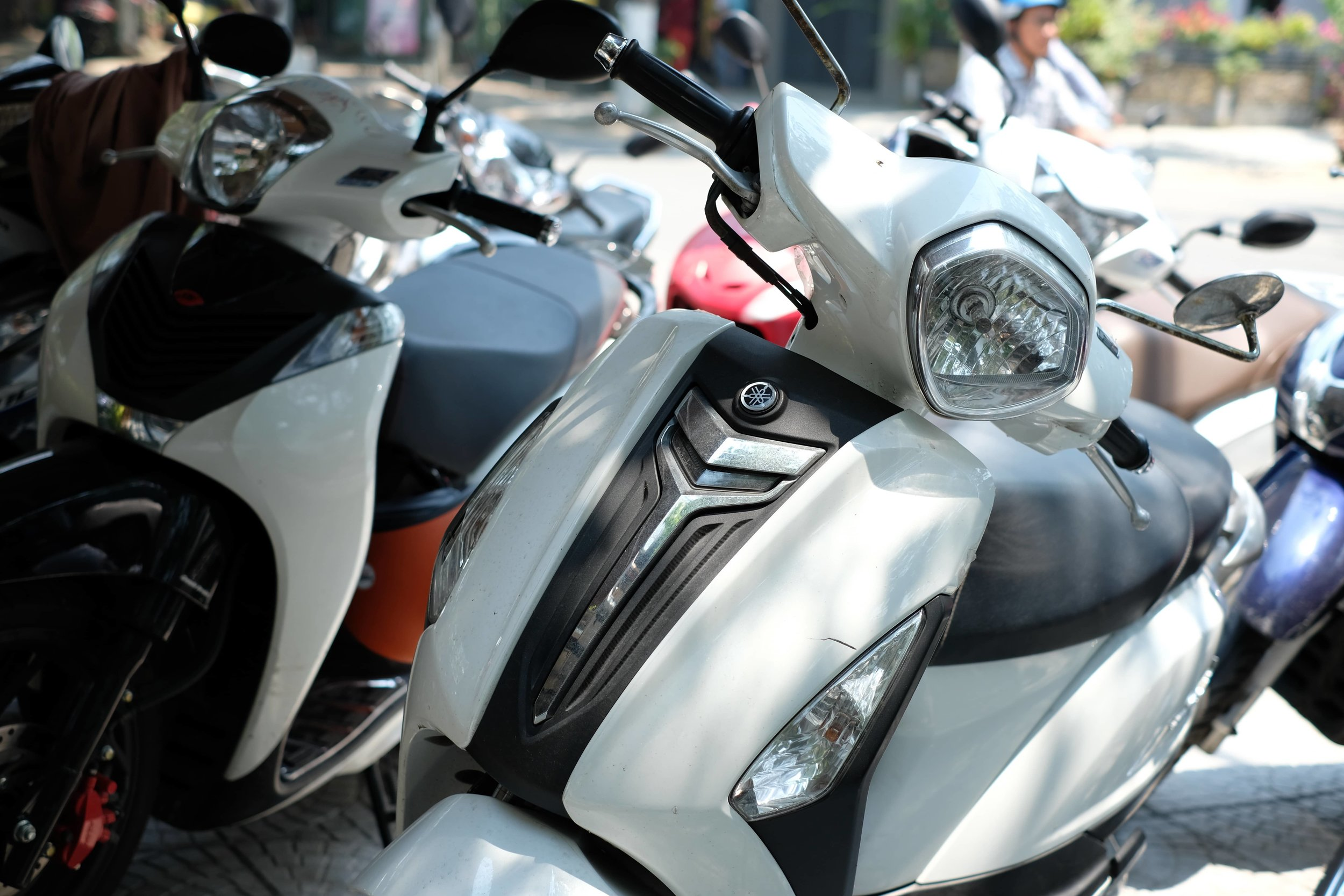 Rent a Motorbike -  The most popular and cheapest option is to rent a moped. You can rent these in either city for $5/day.