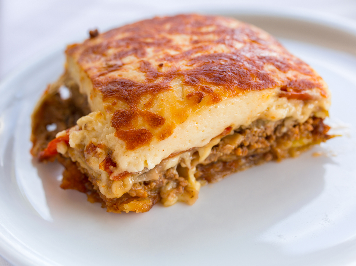 Mousaaka -  A world famous, traditional, creamy and juicy dish. Moussaka is essentially the Greeks answer to lasagna. Moussaka consists of tomato sauce which is used to cook minced beef and is subsequently layered with sweet eggplants and creamy béchamel sauce. This is one of our all-time favorite dishes! Best served with a glass of wine and a dessert of Galaktoboureko.