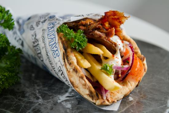 Souvlaki -  Souvlaki is one of the most popular Greek foods. You can find this dish on a side street food cart or a fine dining restaurant. The dish consists of seasoned meat and then flavored with tzatziki sauce. In Greek language Souvlaki stands for 'meat-on-a-skewer even though the most common way to eat a souvlaki is with a pita bread and veggies.