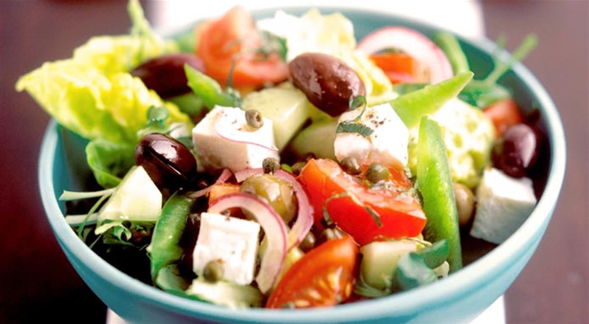 Greek Salad -  Maybe the most famous salad in the world, a Greek Salad is tomatoes, olives, onion, cucumber and a large piece of feta cheese and is served undressed. Dressings are usually left for each person to choose: vinegar, salt, pepper or olive oil.