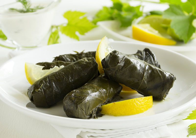 Dolmadakia -  Better known as Stuffed Grape Leaves, this is yet again, another quintessential Greek dish. Inside the leaf you will get meat of ground lamb or beef (sometimes both) and rice stuffing. Traditionally, this dish is served as appetizer with lemon wedges.