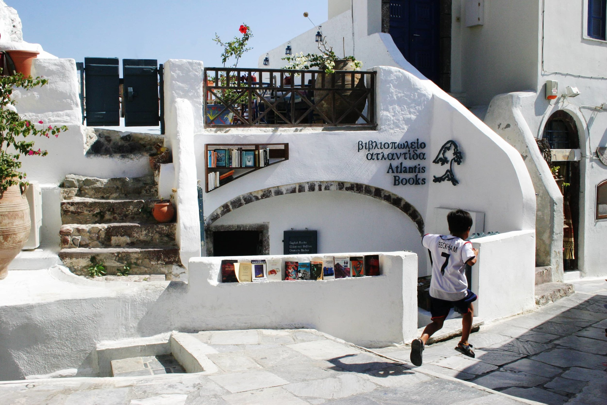 Atlantis Bookstore     - This underground cave is the island's only book stop. They have everything from classic literature to modern fiction and it's unique use of space and book nerd art, makes this an easy spot to relax on the rooftop overlooking the Caldera cliffside.