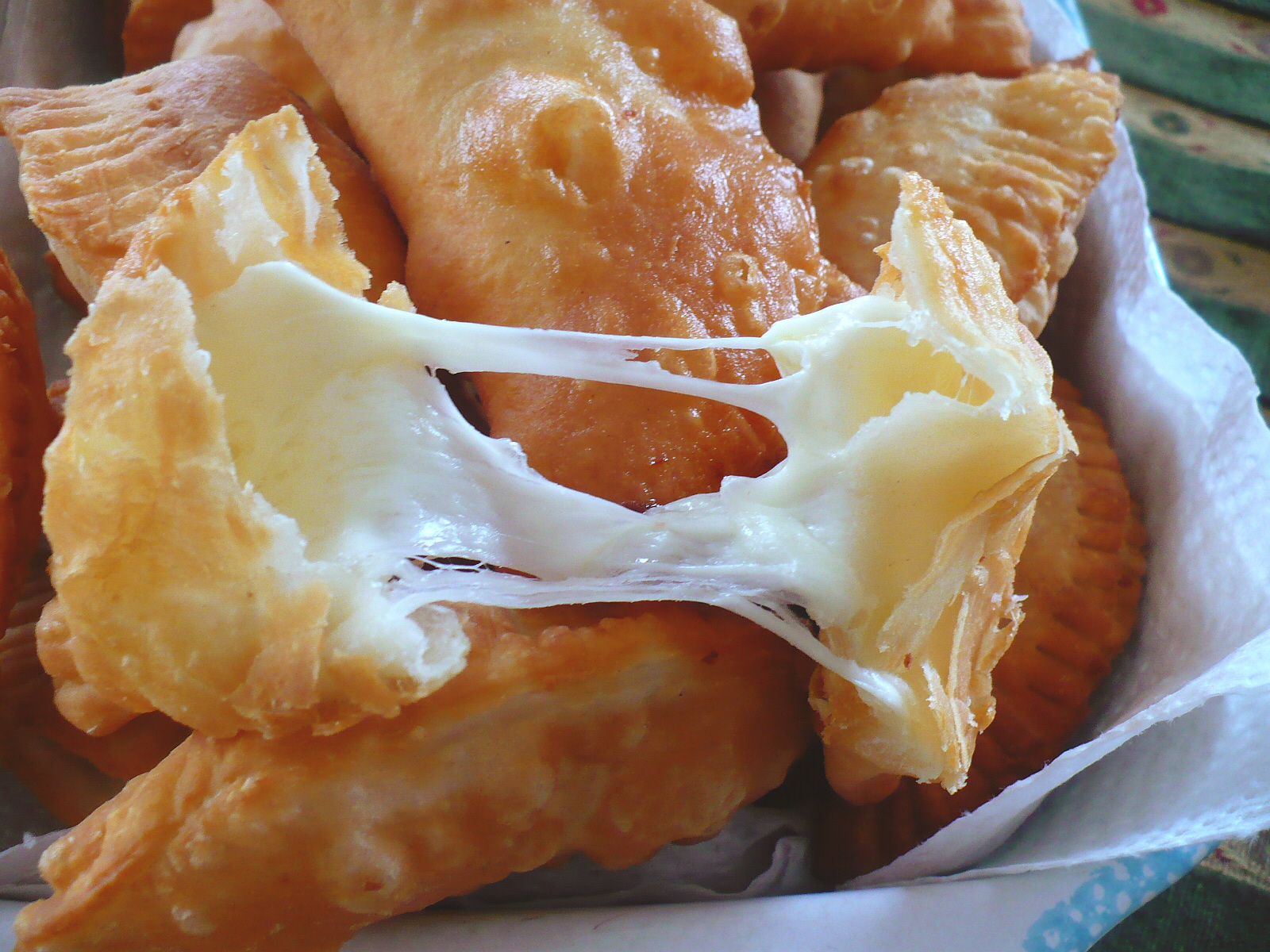 Empanadas  - These fried or baked dough pastries are usually filled with either cheese, seafood or a mixture called  pino , that consists of ground beef, olive, egg and onion. Our personal favorite was simply: cheese, shrimp (prawns) and Chilean hot sauce! Yum!