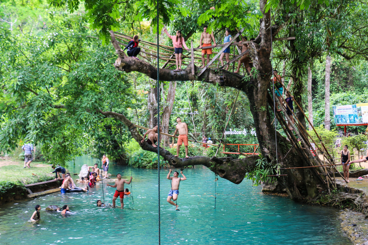 Vang Vieng: Relax at any of the numerous blue lagoons, and caves. Rent a buggy car and drive either way out of town. You will find numerous caves and lagoons that you can explore, swim and relax.