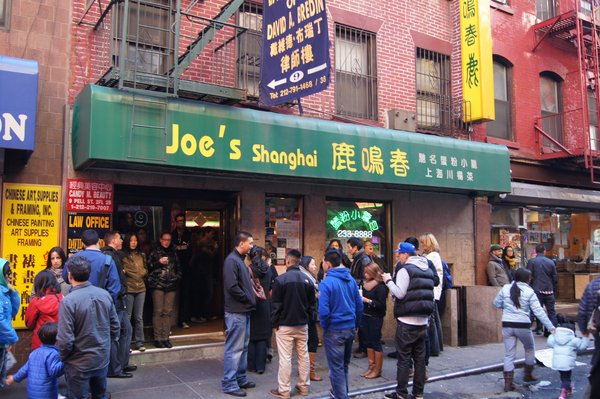 JOE'S SHANGHAI.  This Chinatown staple has the best soup dumplings EVER. Be careful, the food is HOT, and the service can be less than friendly, but hey, that's part of the experience. The hours can be spotty, but you can get equally good soup dumplings at  Shanghai Asian Manor . ($15 per person)