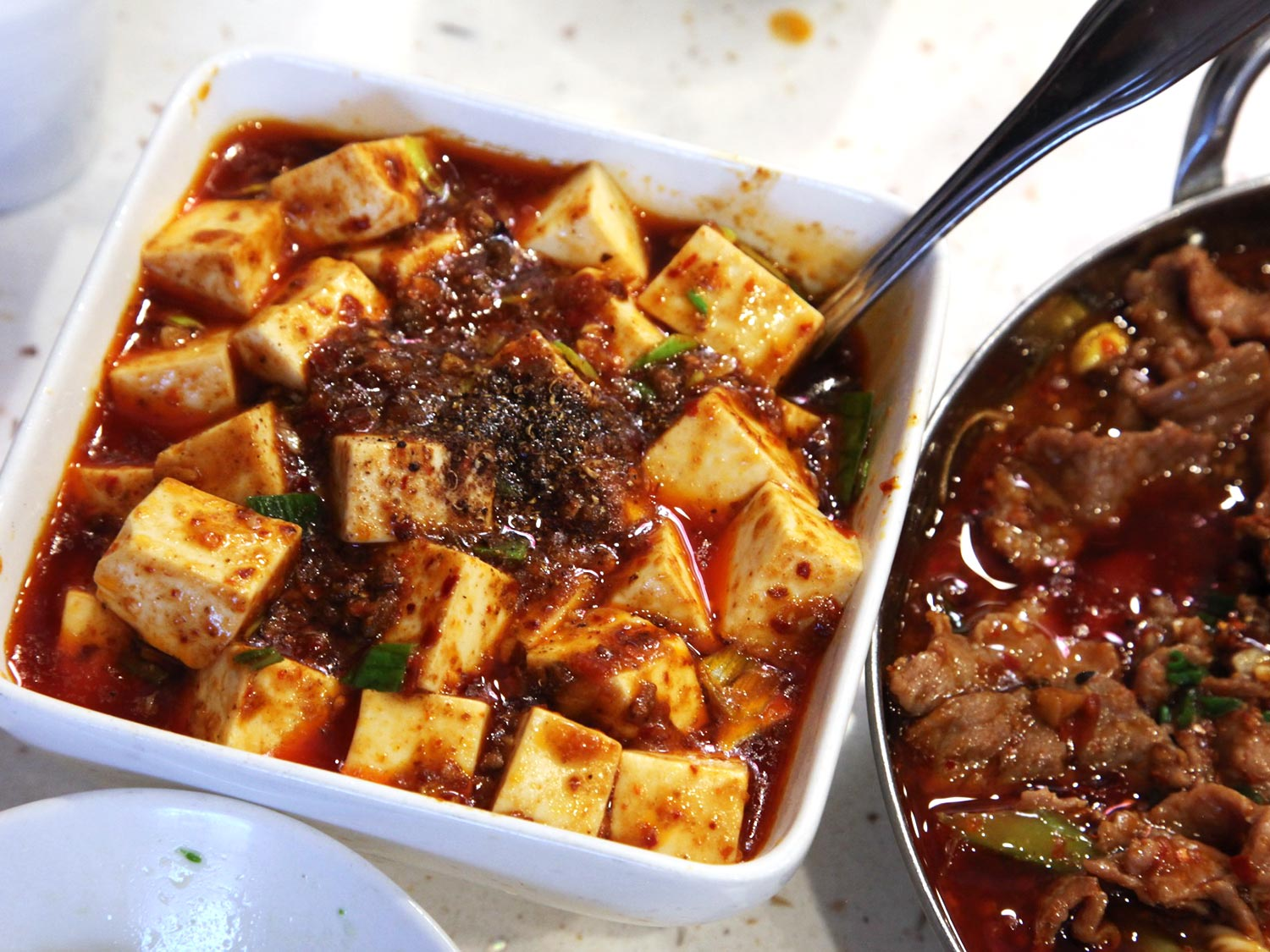 Mapo tofu (má pó dòu fu 麻婆豆腐) –  Possibly the best tofu dish ever, mapo tofu is cubes of tofu in a slick, oily, salty, savory and often quite spicy sauce with minced pork. Chen Mapo Tofu restaurant in Luomashi is famous for their version but most restaurants will serve one that is at least half-decent. Averages around 20-40 Yuan.