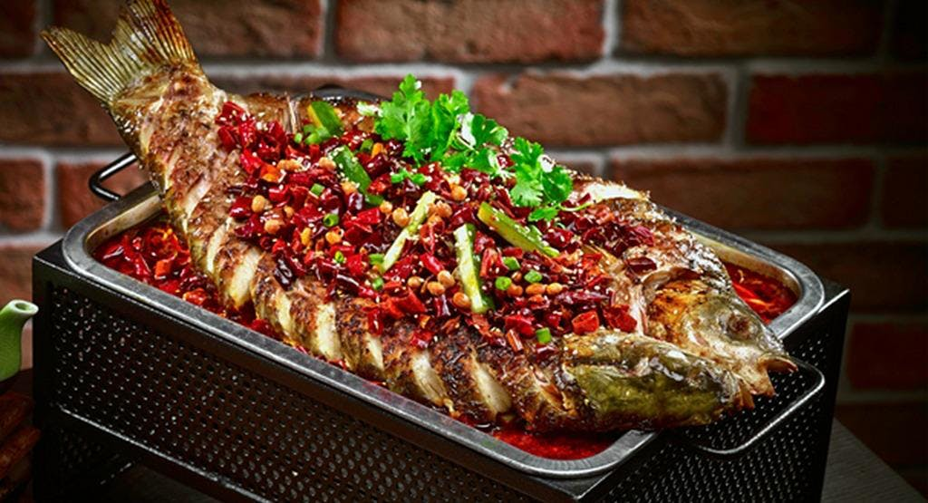 Roast Fish (Kao yu烤鱼)  – My favorite dish in Chengdu. Grilled whole until it's crispy and then submerged in spicy oil with vegetables. Expect to pay 100-150 Yuan depending on the size of the fish.