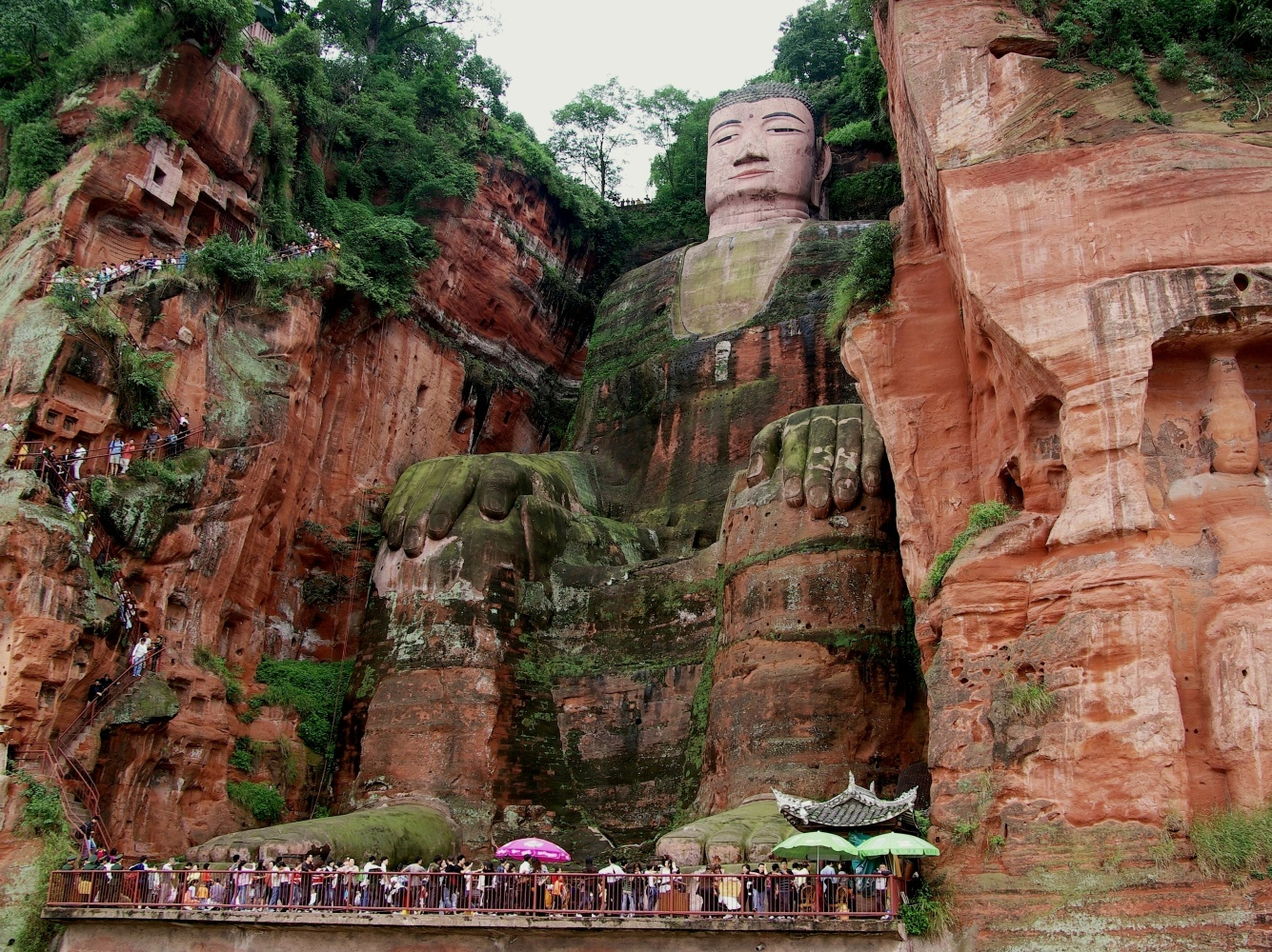 Some people will use Chengdu as their base and head to Leshan (乐山) to see the  Giant Buddha . While undeniably spectacular, it can also become torturously busy, so consider staying for a night in Leshan (it's famous for its snacks) and waking early to go the Giant Buddha. If not, there are clearly marked buses from the train station and a lot of taxi drivers who know where you want to go and are very eager to offer their services to you.