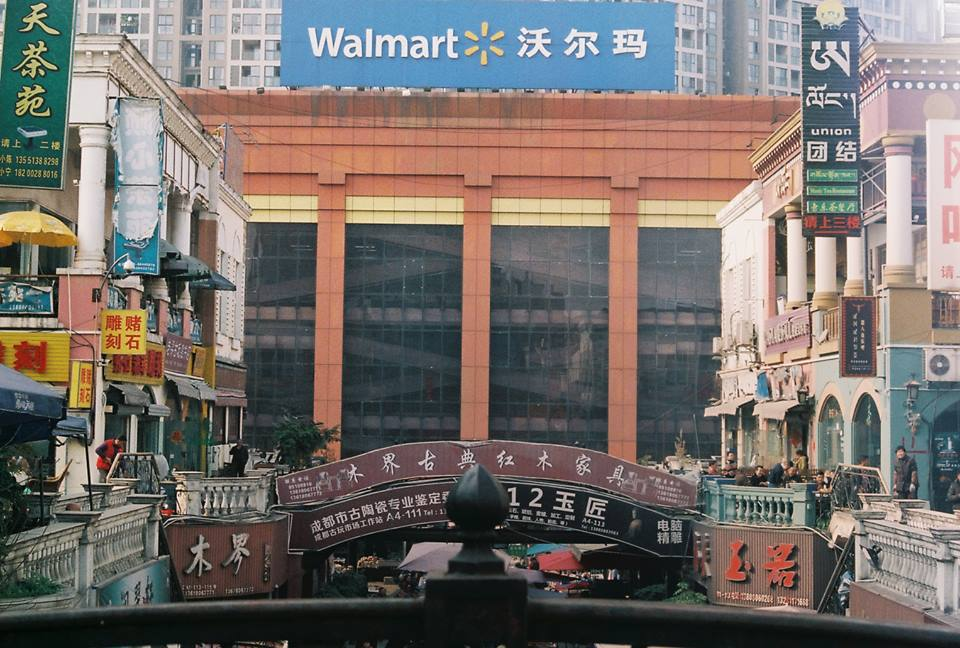 One of my favorite markets is 罗马假日广场, or  'Roman Holiday Square'  in the west of the city. Take the line three metro to Gaoshengqiao (高升桥) and get out at gate B. Take the first right away from the main road and work your way down through the alleys until you find it. On a good day it's bustling with local people and Tibetans. Inexplicably, looming over the whole thing is an enormous Walmart, but pay no mind to that. Outside the market is a prominently Tibetan population with some great restaurants tucked away.  Wuhou Temple  and  Jinli Street  are also nearby, and while the latter in particular is quite touristy, they are worth a look.