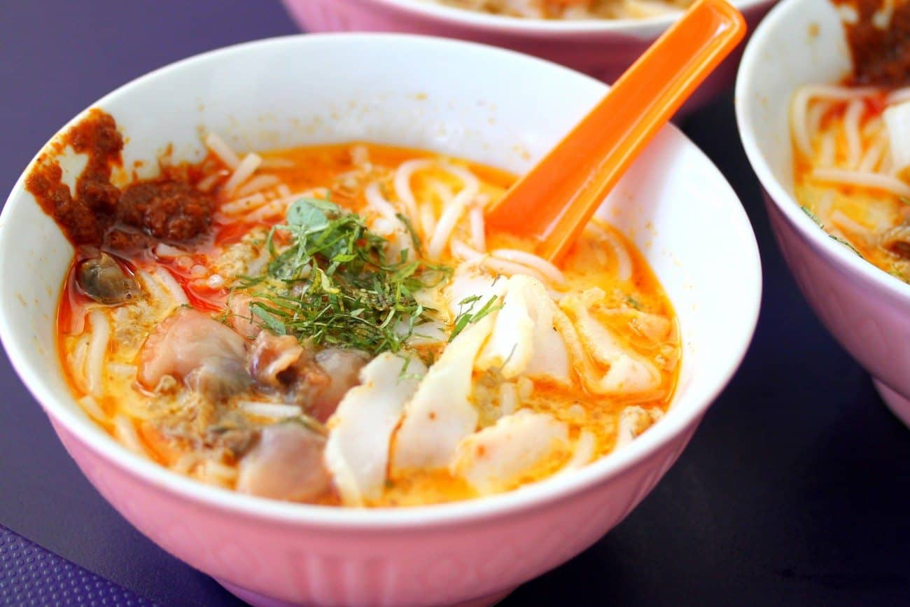 Laksa  - Laksa is a spicy noodle soup popular in Peranakan cuisine. Laksa consists of rice noodles or rice vermicelli with chicken, prawn or fish, served in spicy soup based on either rich and spicy curry coconut milk or on sour asam. Laksa is found in Indonesia, Malaysia, and Singapore.