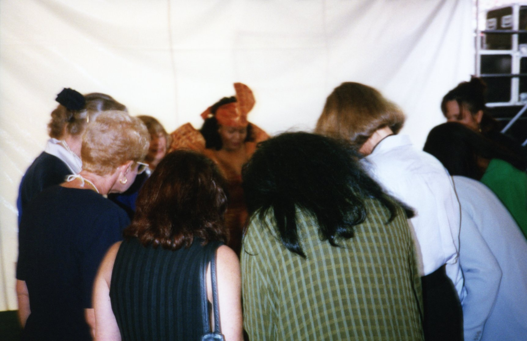 Women praying before the event