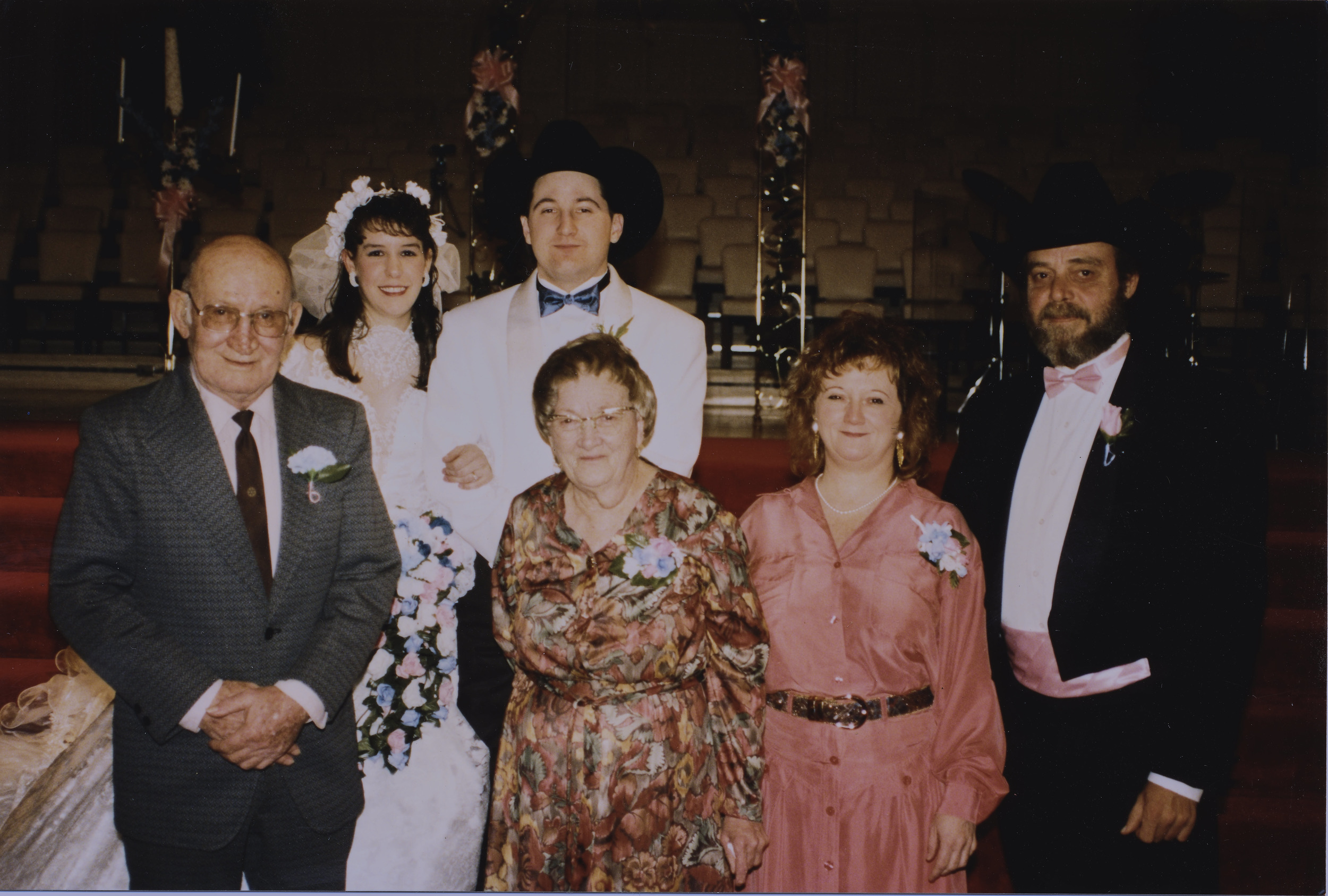 This is the image that reminds  why I do what I do! My wedding day with my grandparents, mom and her husband LT. (Yes that is me with a cowboy hat on)
