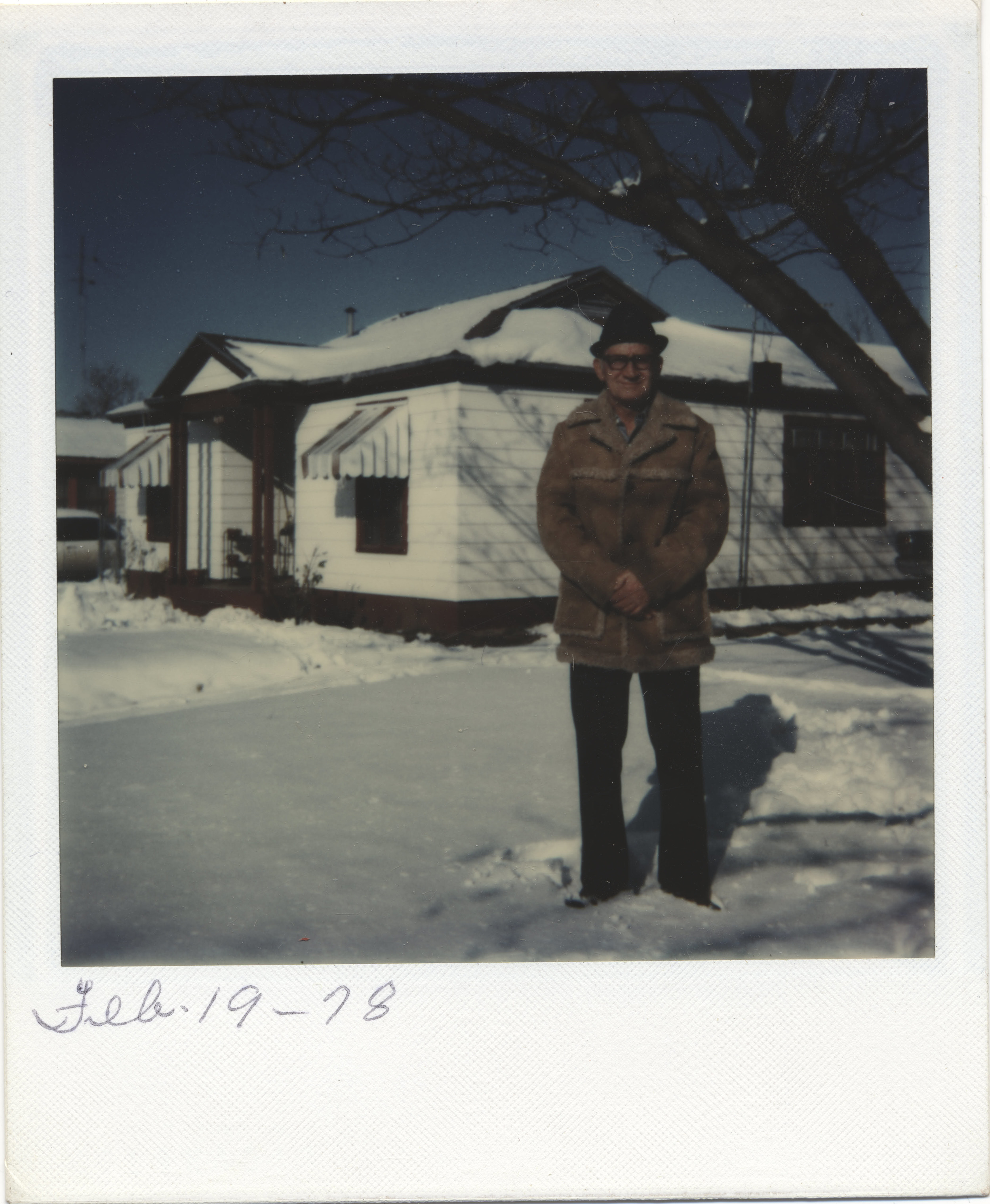 My grandfather in 1978, yes that is snow in Fort Worth Texas. Polaroid FIlm