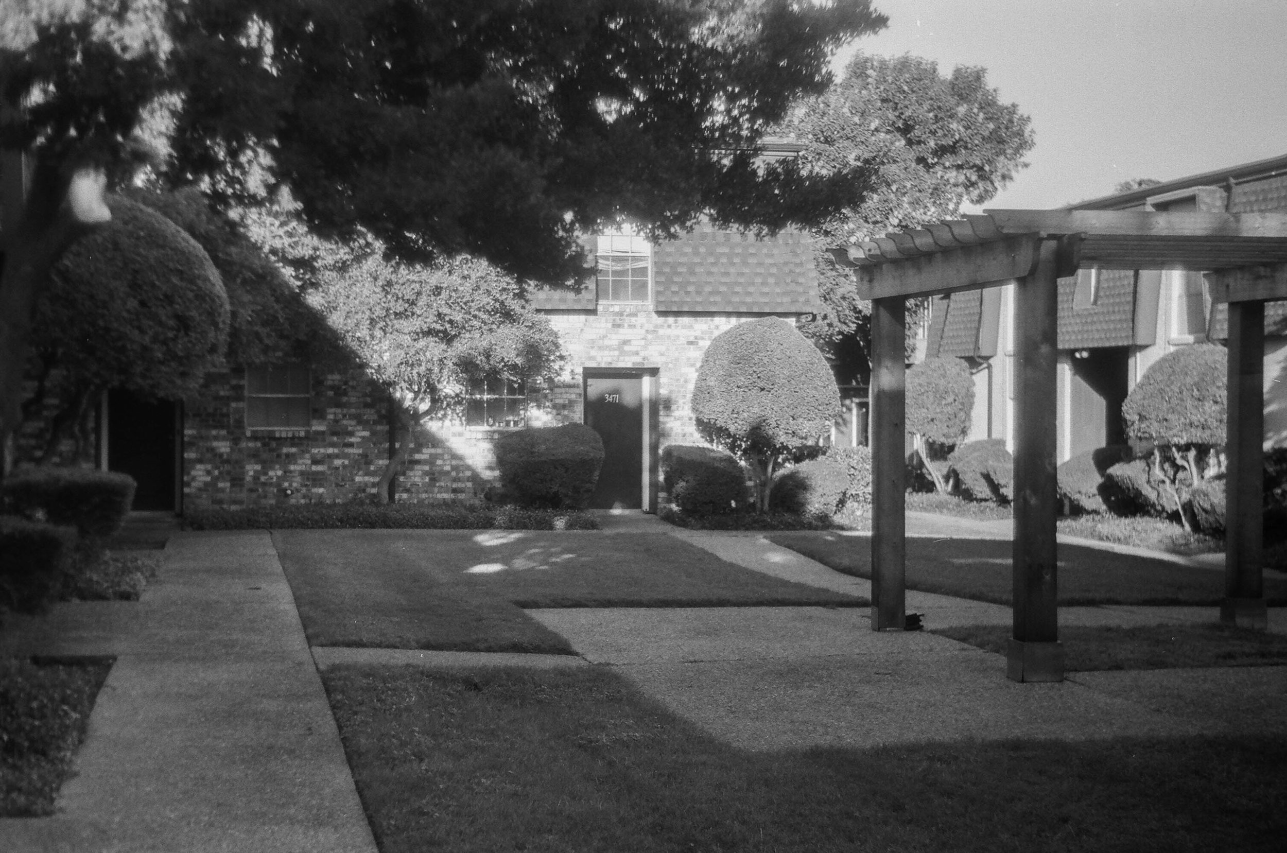 This was the courtyard of our 2nd apt. The pergola was not there int he 80's. 1980's Zorki 4 | Ilford HP5