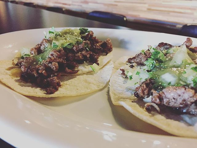 Happy hour tacos. Carne asada, house made salsa verde, onions and cilantro on corn tortillas. So simple but so good!