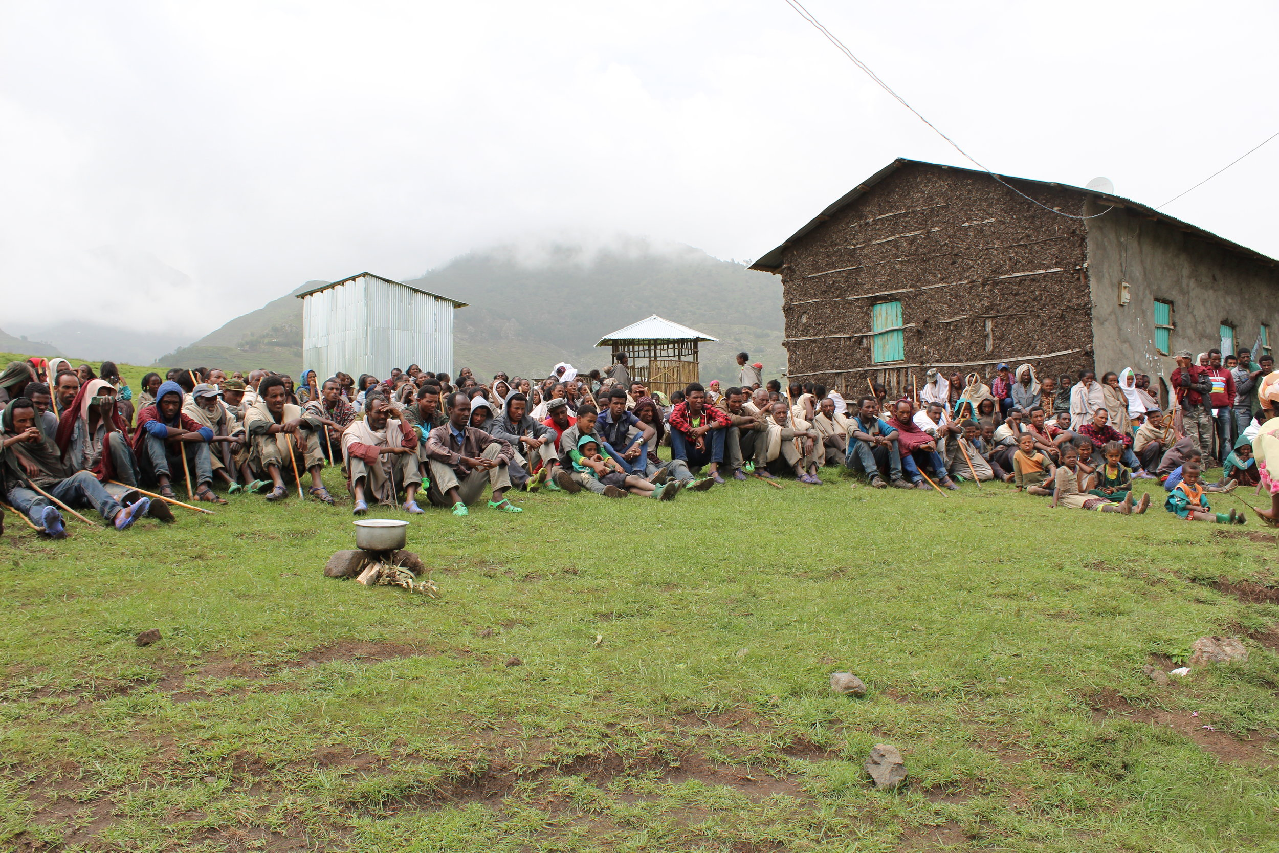 People gathered for a stove demonstration in the mountains of Northern Ethiopia. You can see the three-stone fire, which is the traditional way of cooking in many developing countries.