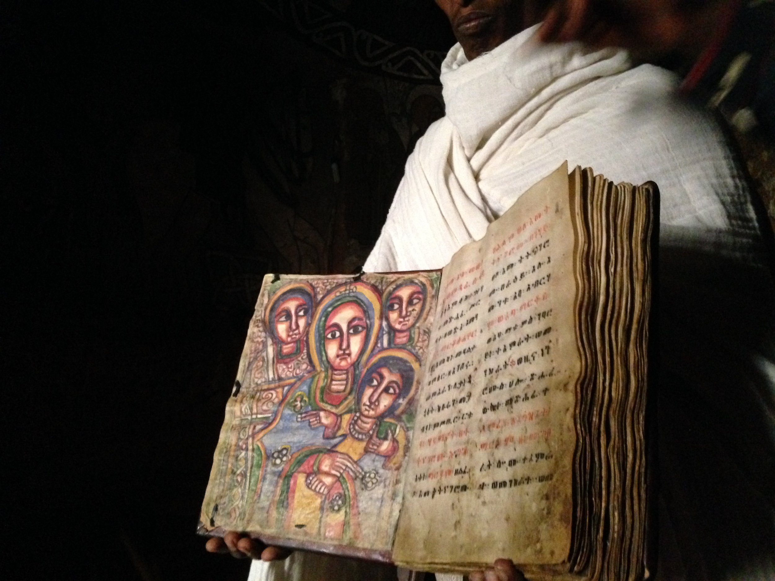 Priest showing us the ancient scriptures that are made of goatskin.