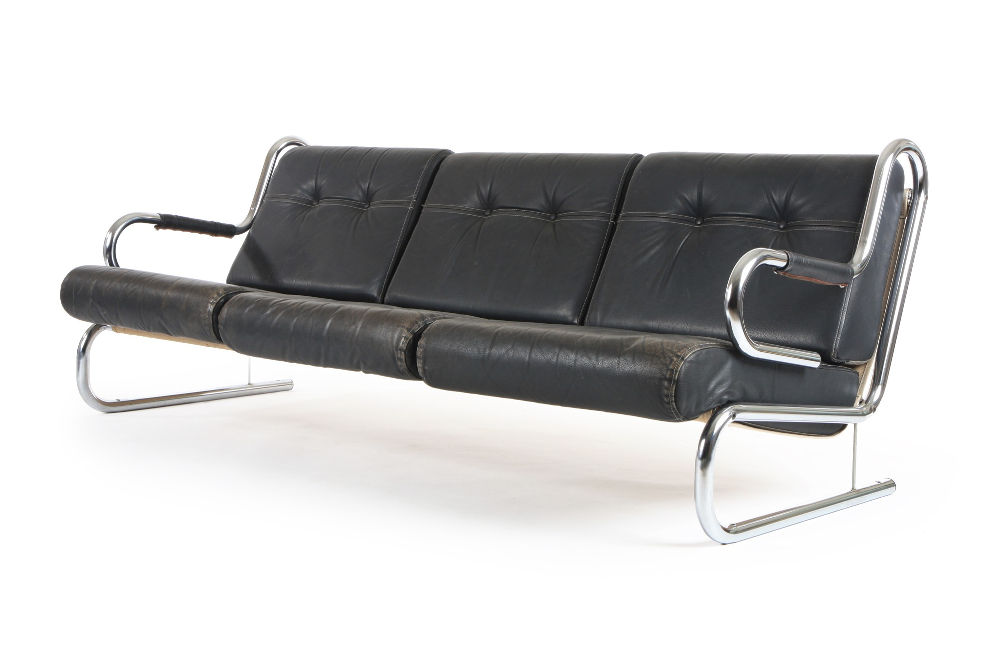 This leather and chrome sofa from Mr. Bigglesworthy   is characterised by a refined lightness of form, flowing lines and the perfect blending of leather and mirrored chrome. A sofa that captures the British high-tech modern style of the late 1960s.