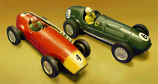 Very early Scalextric slot car models in 1:30 scale, circa 1957. These metal-bodied racers were electrified versions of Scalex clockwork cars, and are among the first commercially offered slot cars of the modern era. They represent the Maserati 250F (left) and the Ferrari 375 Grand Prix cars. | Image Credit:  D. Helber via Wikipedia.