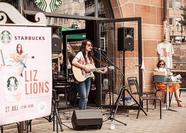 ". WHAT A MAGICAL DAY!🦁🌟 . The Liz and the Lions/ Starbucks show yesterday was so fun and such a great reminder to how wonderful the city of Nürnberg is. So many Lions came out to enjoy live music, drink ""Lion Fraps"" and be together. .  A big thanks to @starbucks @yvonne_bender1 for hosting us. @thewhiterabbitarts for running the sound @guy.palumbo and @stephenvoltz  for play. @florentina_mak for tagg teaming w/ me @alexreibrich for the great photos! @bardentreffen_nuernberg  for supporting music!!! . AND THANKS NÜRNBERG FOR COMING OUT!!!! 🦁🦁🦁🦁❤️❤️❤️❤️🌟🌟🌟"