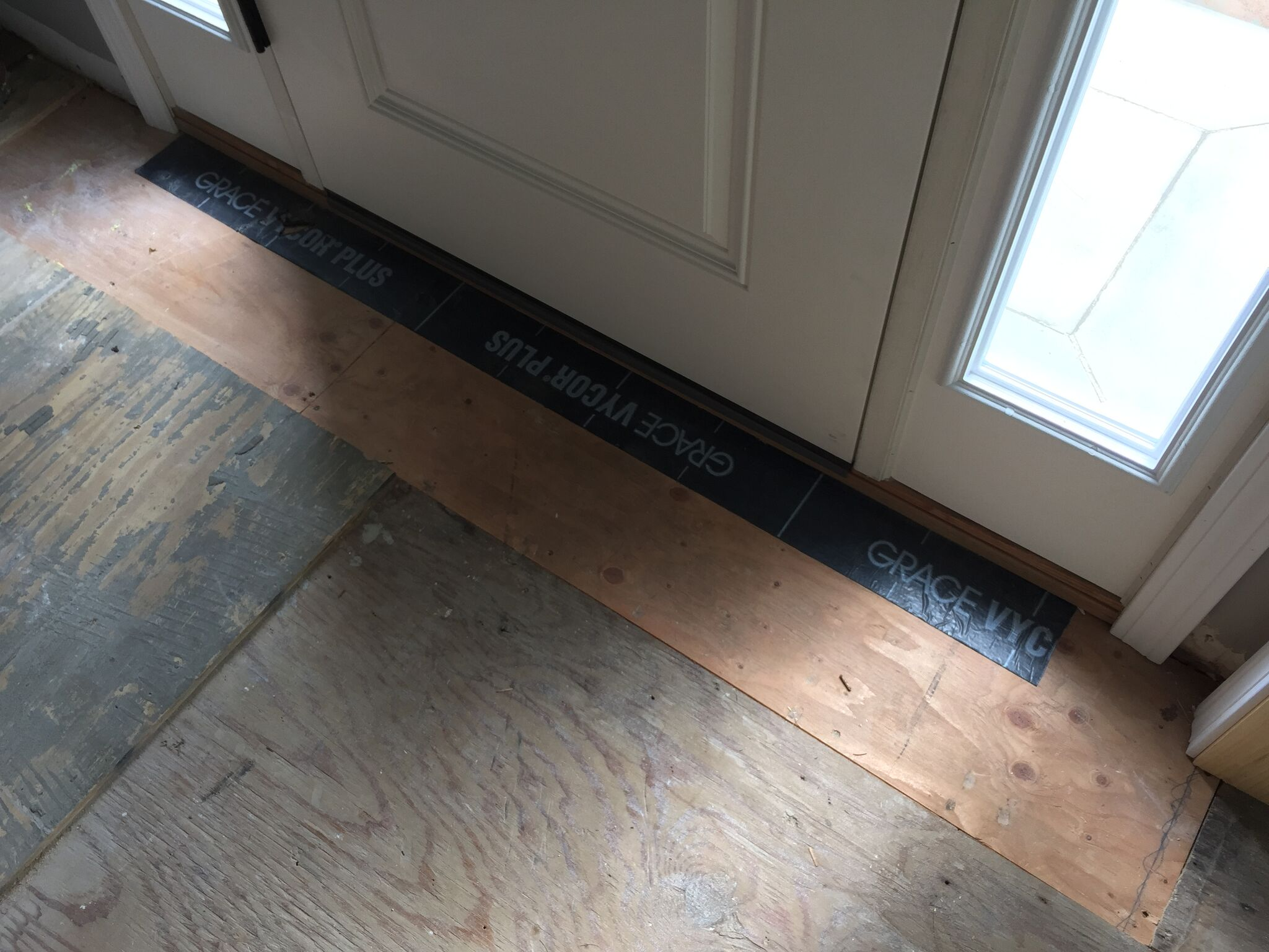 New plywood flooring and flashing tape to protect area by door opening