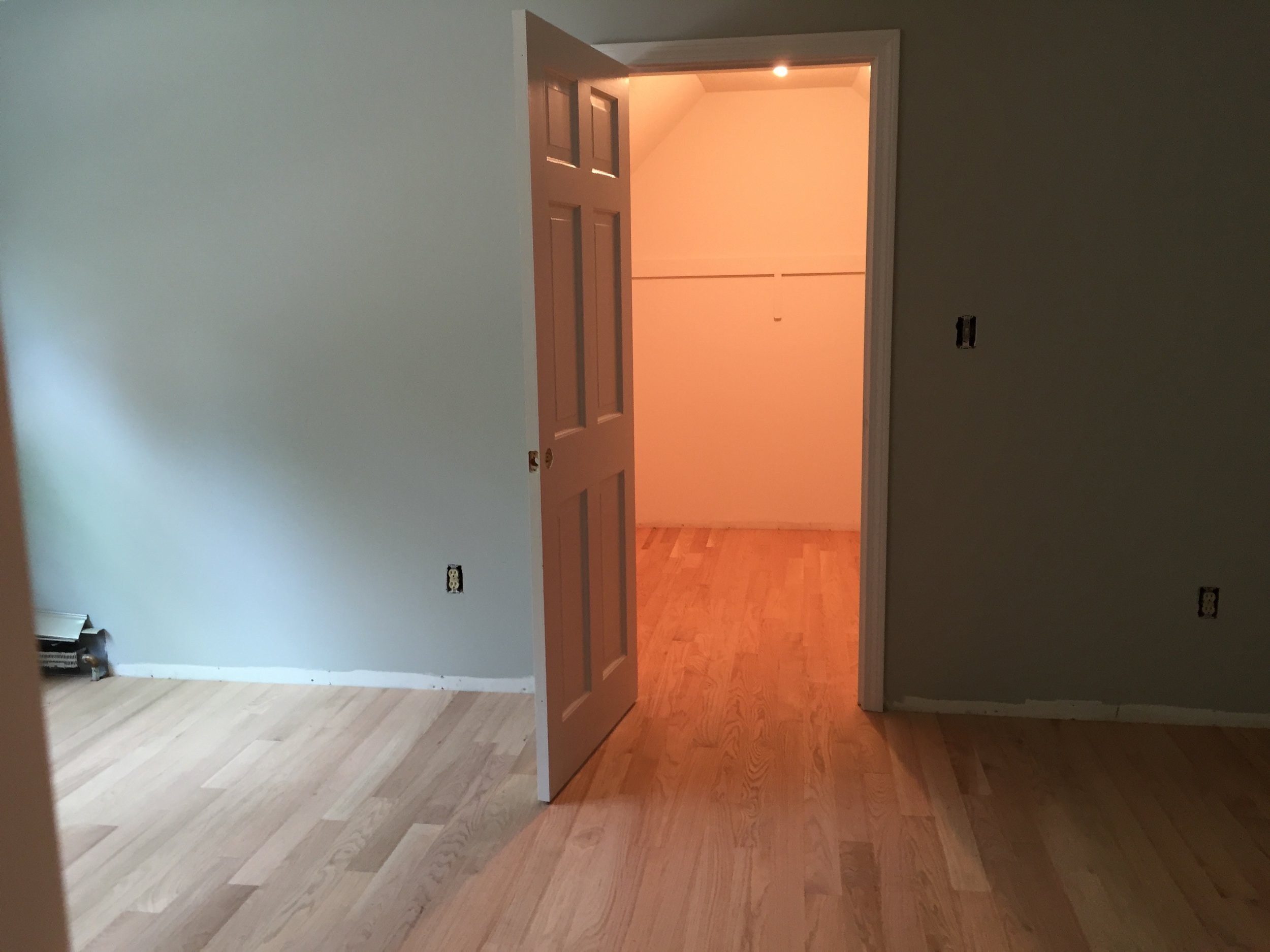 AFTER - Bedroom and closet with new red oak flooring installed (unstained)