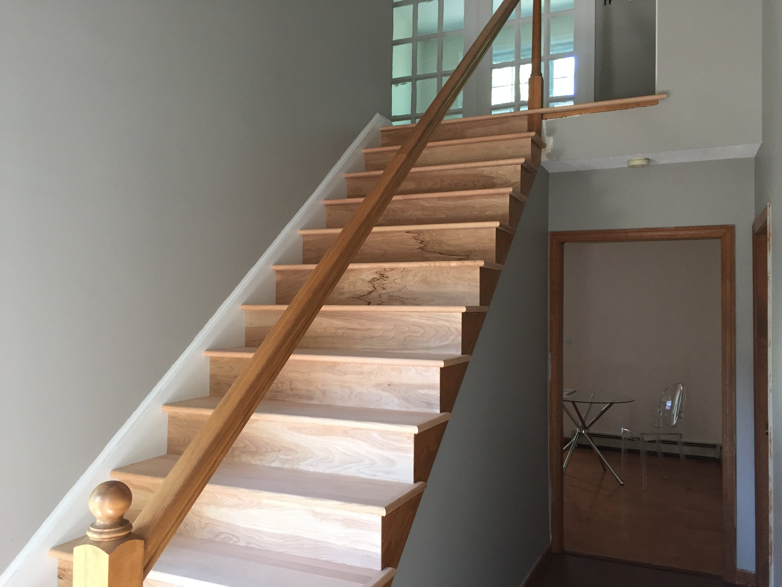 PROGRESS - Entry Stairs new red oak treads and risers installed (unstained)