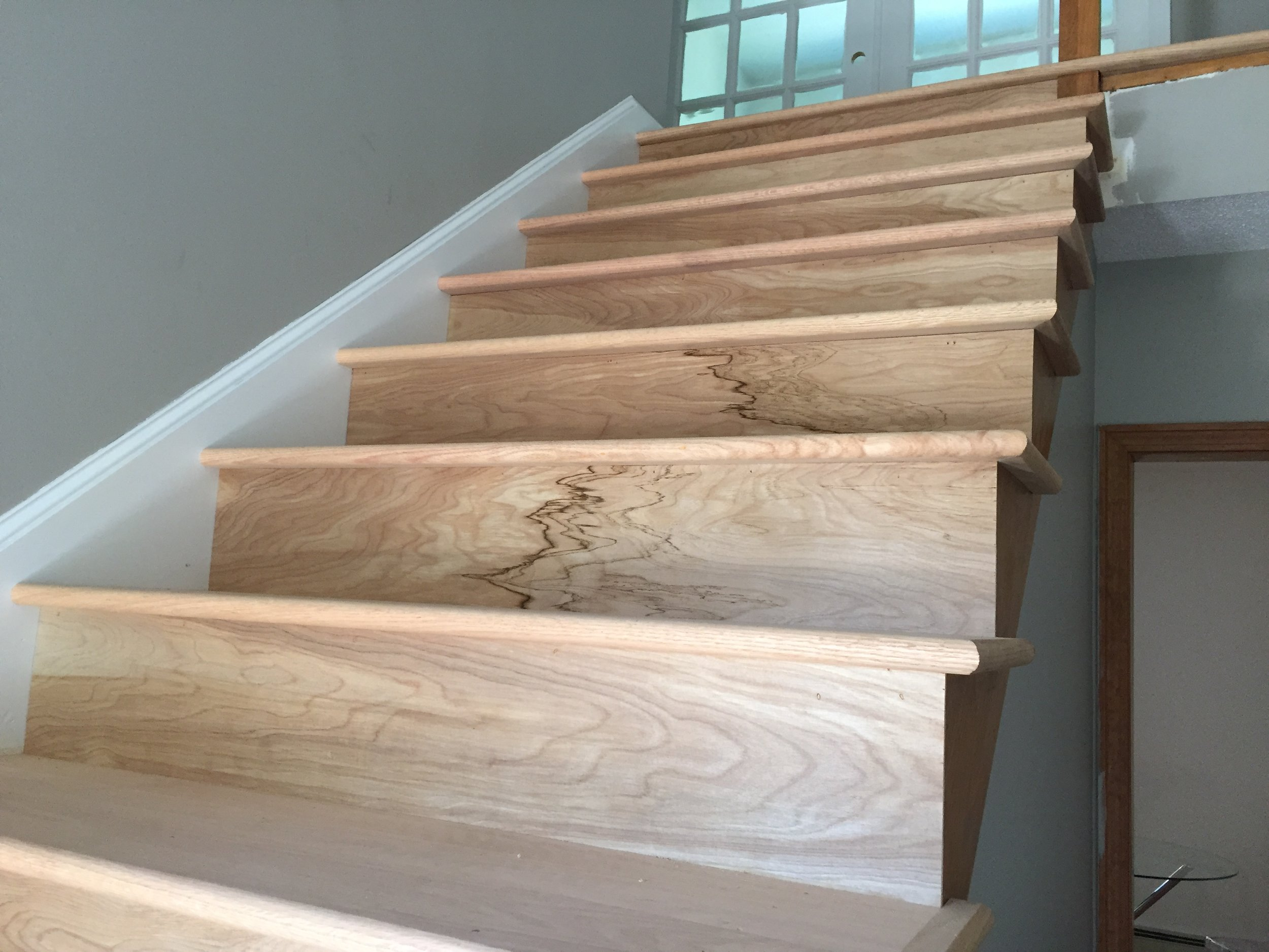 PROGRESS - Entry Stairs closeup of red oak boards (unstained)